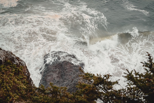 Looking over the edge as the waves crash into the rugged Oregon coastline.