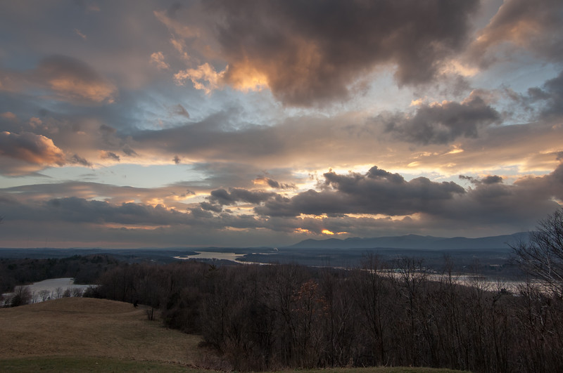 panorama SW w/dramatic clouds, more trees