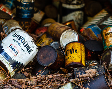 Discarded Motor Oil Cans