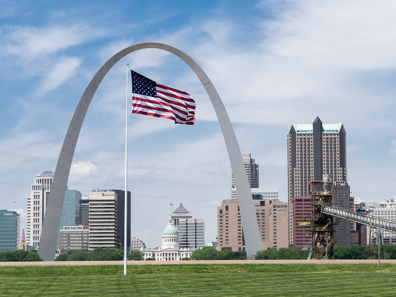 The American Flag with the Gateway (St. Louis) Arch and Downtown St. Louis in the Background