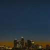 Saturn and Jupiter over the business district of downtown LA at twilight.
