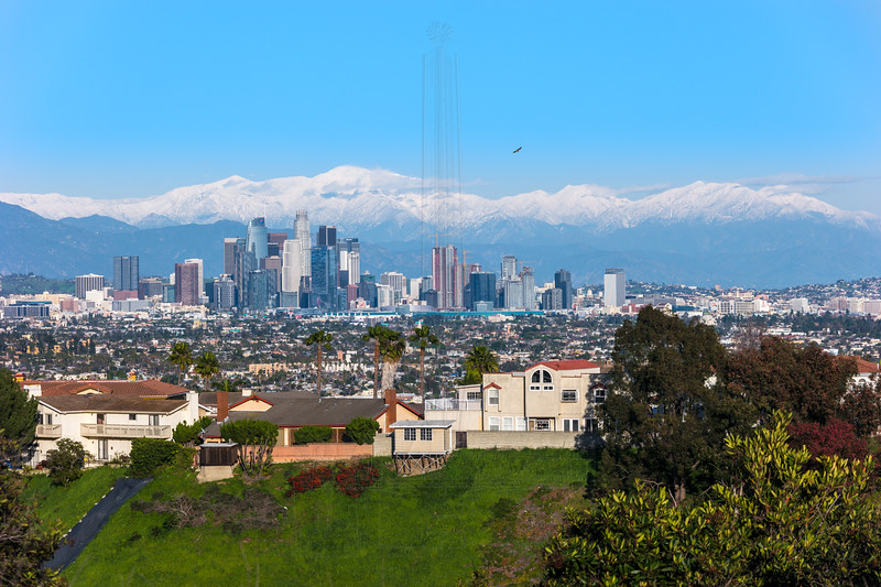 Downtown LA with snowcapped San Gabriels.