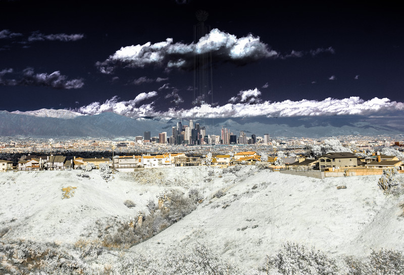 Tight shot of Downtwn LA with snowy San Gabriels.