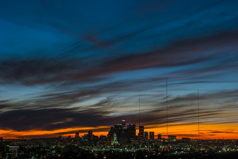 The light of the sun fades and the light of downtown LA's building spring to life.