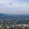 Goodyear blimp over the Rose Bowl.