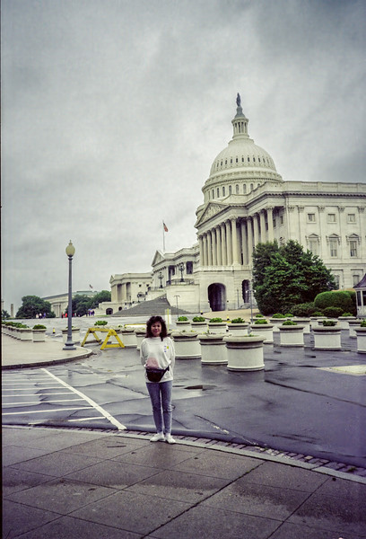 Madame, with the east front of the Capitol behind her.