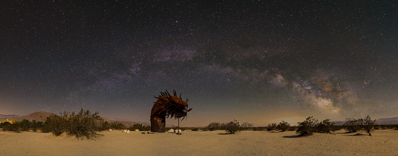 Composite of the sea serpent panorama with a Milky Way panorama shot at Fossil Falls.