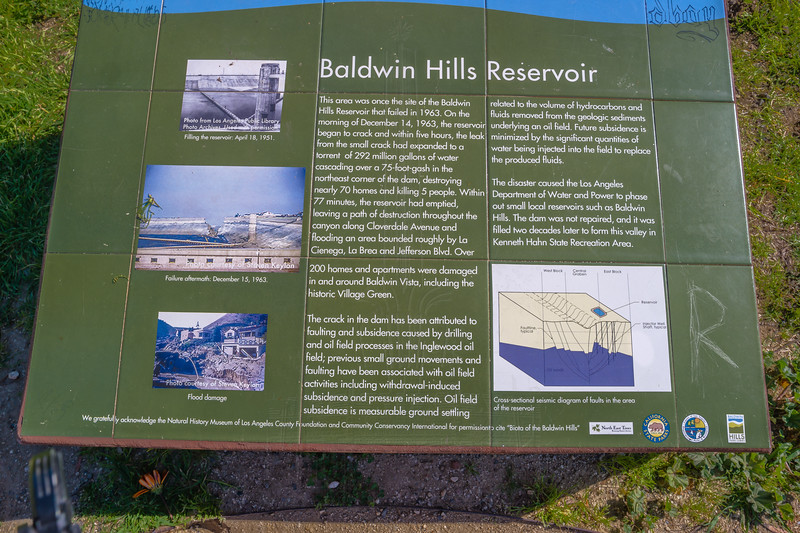 Informational sign at north side of grassy bowl.