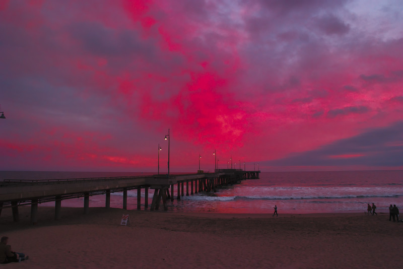 Red clouds hang over the Venice Pier.