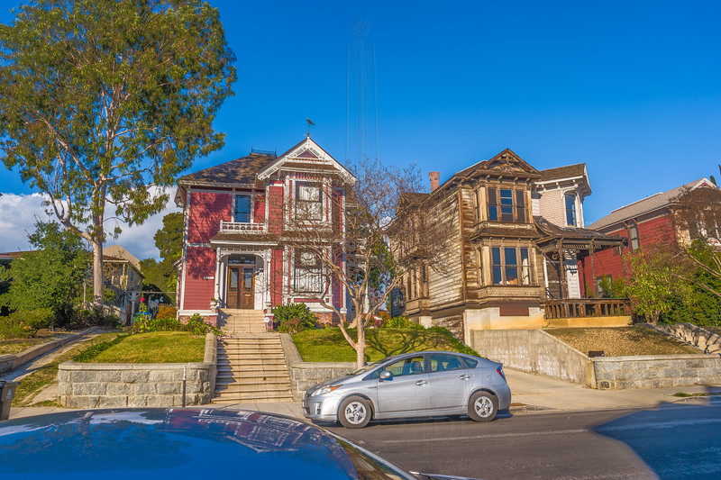 """I believe the house on the right is a more recent arrival and is getting """"some work""""(not uncommon in LA) done. Nice looking Prius there!"""