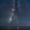 Milky Way and Jupiter reflected in the Pacific Ocean.