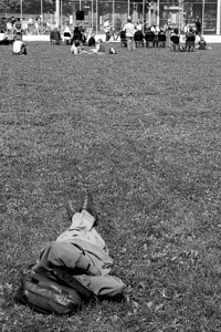 Keeping his distance.   During a homeless protest, a homeless man lies on the grass away from all the noise