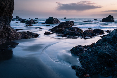 The softness of the water contrst with the hardness of the rocks.  Southern Oregon Coast.