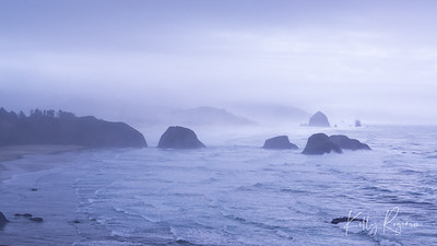 A foggy and cold afternoon along the Oregon Coast.  A view from Ecola State Park looking down on Indian Beach and Cannon Beach along with Haystack Rock in the distance.  Could never be a more beautiful view.