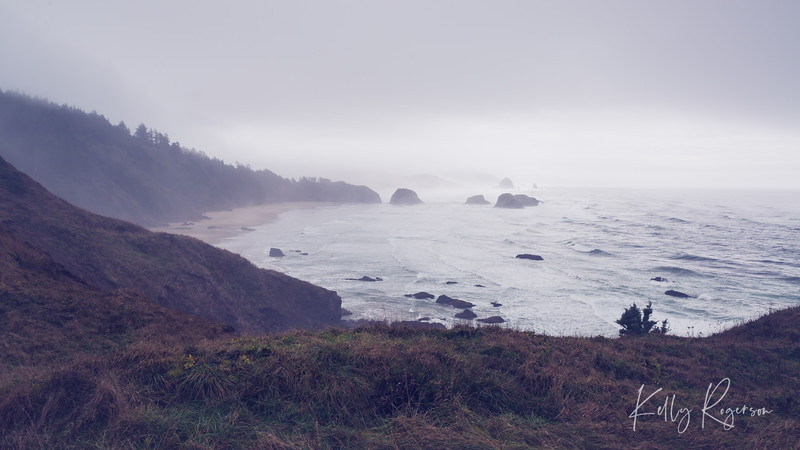 A foggy day on the coast of Oregon can present you with an array of different colors depending on so much, and it can seem to vary from one storm to the next. It's one of the amazing wonders of the Oregon coast, and the nature mother naure provides us. This overlook is from Ecola State Park, overlooking Cannon Beach shoreline. Off in the distance you can see Haystack Rock!