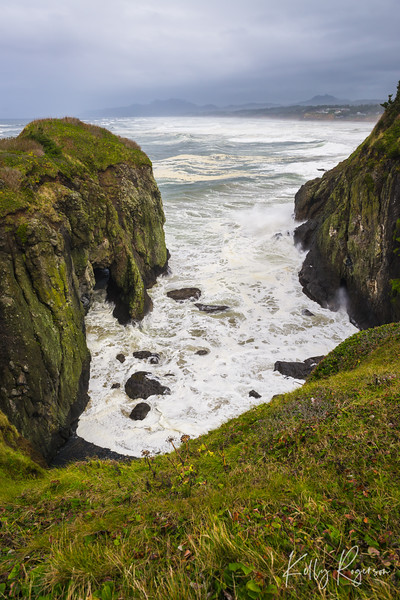 The beauty of waves as they crash into the cliffs and rocks below Yaquina Head Lighthouse, Oregon.