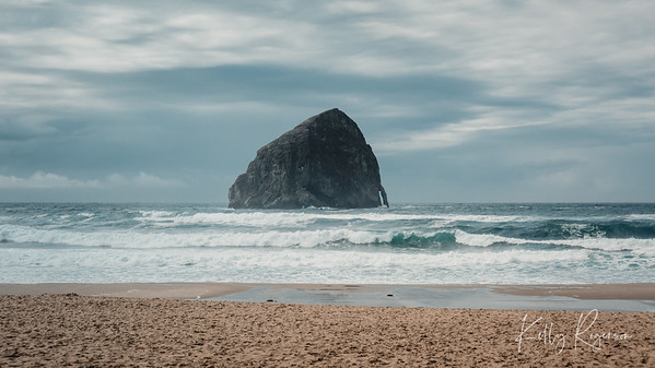 Cape Kiwanda on the Oregon Coast during a cloudy day.