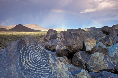 Petroglyphs and rainbow at Signal Hill in Saguaro National Park outside of Tucson AZ.