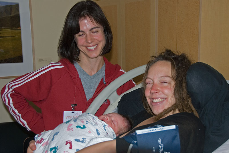 Katie and Dave's girlfriend, Katrinka Reinhart, enjoy Oliver's first moments of life.