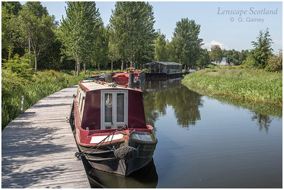 Forth & Clyde Canal - holiday hire boats moored near Falkirk Wheel