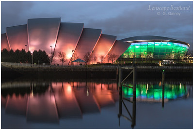 Scottish Exhibition Centre (the Armadillo) and SSE Hydro illuminated at dusk