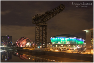 SEC 'Armadillo', Finnieston Crane and SSE Hydro illuminated at dusk