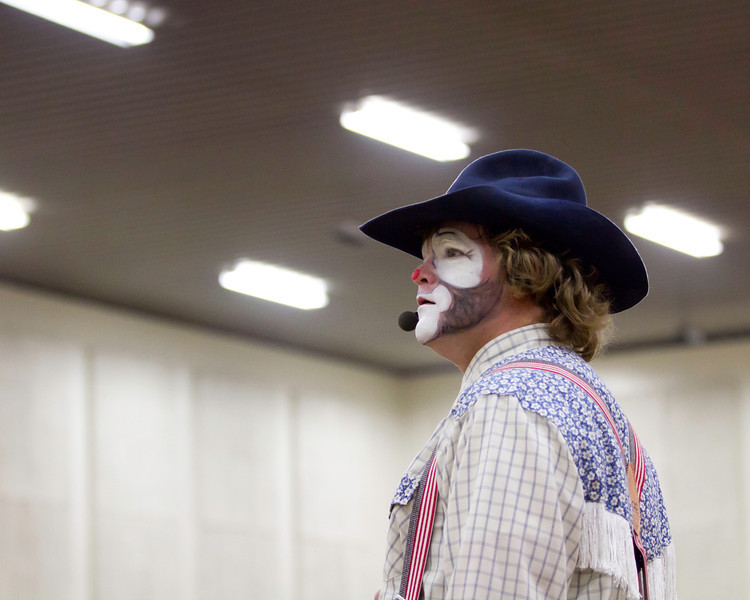May 13th, 2013<br /> <br /> I shot my first rodeo this last weekend.  This is one of my favorites from Saturday night.<br /> Unfortunately, it was an indoor rodeo under overhead fluorescent lighting. Even with a 70-200mm f/2.8 lens, the 7D body I was using was maxed out ISO wise and keeping the shutter speed above 1/200 came down to what color the bull riders were wearing. <br /> <br /> I understand that indoor arenas are an entirely different animal than outdoor rodeos. If I had been outdoor with the same lens/body set up and natural lighting, I wouldn't have had issues getting crisp images. <br /> <br /> If I encounter these conditions again I was wondering about changing up my gear a bit. I know that off camera flash units are an option, but I am inexperienced with that gear set up. I watched a vet sports photographer shoot with a 1D body and a Sigma 120-300mm EX lens. I was thinking that perhaps swapping the 7D body for my 5D body, and changing the lens to something akin to a Sigma EX 120-300, and monopod of course, would be the better way to go? You sacrifice chances at the shot for better image quality...<br /> <br /> Any thoughts?