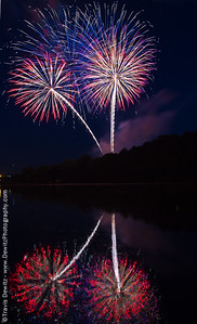 Fireworks reflect off of Halfmoon Lake during Eau Claire's 4th of July show at Carson Park.