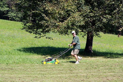 And now Ken cutting the grass.  He never looks this happy doing it at home.