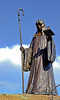 July 3rd, 2010<br /> <br /> This is a statue of a St. Walburga. She was born in England of a family of the local<br /> aristocracy.   At an early age, she was entrusted to the care of the Benedictine nuns in Wimbourne (present-day Dorset) where she eventually made monastic profession.  When her relative St. Boniface, a missionary monk and bishop who worked for the evangelization of Germany, asked for help from other Anglo-Saxon monasteries, St. Walburga became part of a group of nuns from Wimbourne who answered the missionary call.  Eventually she became abbess of the monastery at Heidenheim, a double monastery of men and women founded by her brother St. Wunibald, who served as its first abbot.  The tenth-cetury legend of her life tells stories of her gentleness, humility and charity, as well as her power to heal the sick through prayer.