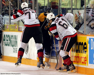 Martindale and Cuma teaming up on a Sarnia player.