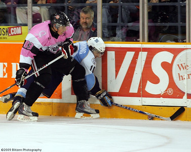 Cody Ceci rubbing Flemming out along the boards
