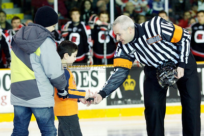 Child cancer survivor Ziad delivers the game puck.  The University of Ottawa medical students held their Shave for the Cure night at the game.