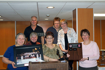The Ottawa 67's Booster Club Executive with the gifts from the Ottawa 67's club acknowledging their 20th anniversary and all the tremendous work they have done for the team over those years.