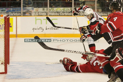 One of a few open net chances that the 67's couldn't bury.