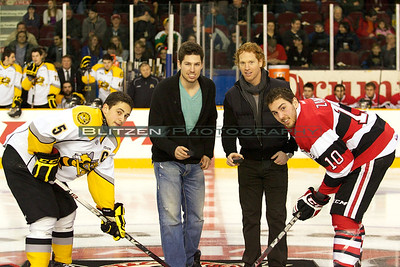 Former Ottawa 67's captains and current NHL All Stars Logan Couture and Brian Campbell drop the puck.