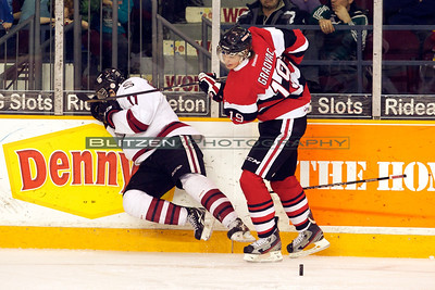 Graovac was called for high-sticking on this move.