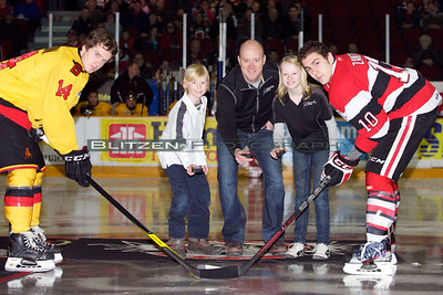 The team's physiotherapist and his children doing the puck drop