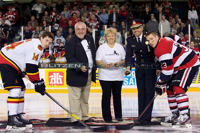 Ottawa Councillor Allan Hubley, his wife Wendy Barber and Ottawa Police Chief Charles Bordeleau drop the puck at the game in support of the Acceptance fund raising program.