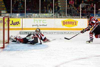 Team work between the goalie and his D...Mrazek pokes the puck to Ceci to keep the puck in play.