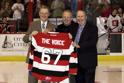 Brian Kilrea and Jeff Hunt presented Dave with a jersey and a golf bag.