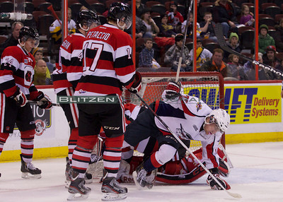 Former 67's Remi Giftopolous getting up close and personal with Clint Windsor.