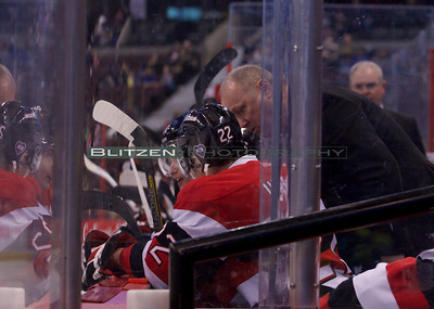 Assistant Coach Larry Skinner chatting with Blandisi