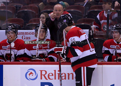 Assistant coach Larry Skinner giving some advice to Mike Vlajkov