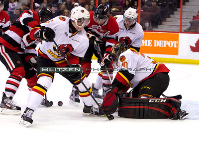 The wayward puck that Monahan would put into the net for his first goal of the game.