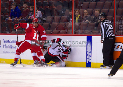 Travis Konecny going into the boards awkwardly.