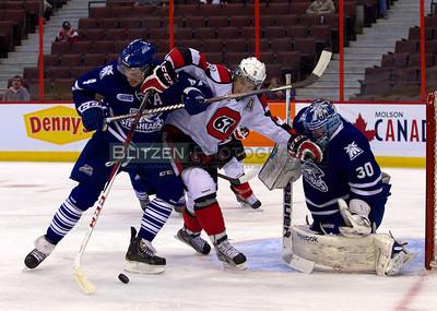 Ryan Van Stralen battling in front of the MIssissauga net.