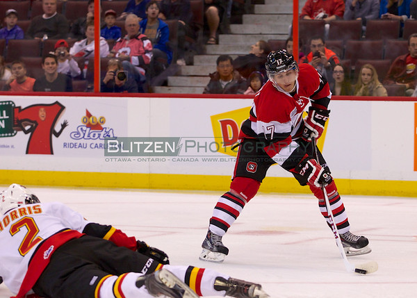 Travis Konecny showing his skills as he prepares to saucer a pass to Stan Studnicki for the first Ottawa 67's goal of the season.