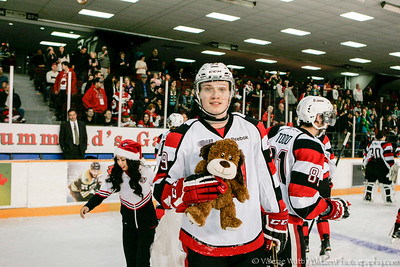 Kevin Groulx with a Teddy Bear that he caused to be tossed.