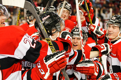 Travis Barron mobbed by his team for winning the game in the shoot out.